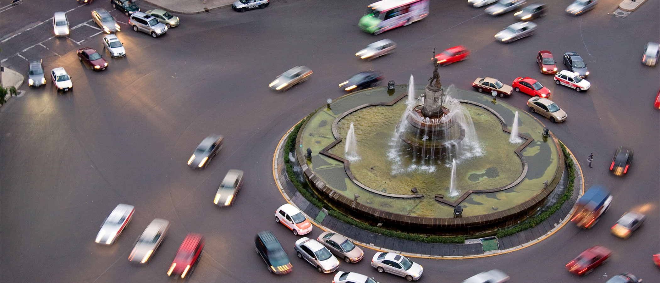 Many cars in a traffic circle in Mexico City, Mexio.