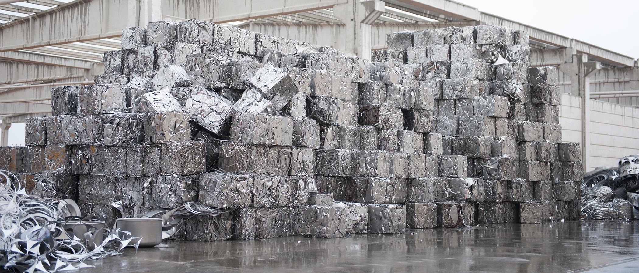 Stacks of aluminium blocks at recycling yard